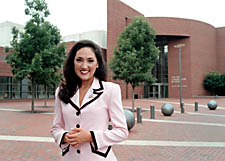 Alumna Tiffany Haas in front of CCM's Corbett Center for the Performing Arts in 2002.