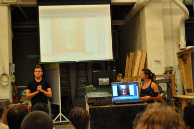 Scenic designer and third-year graduate student Ryan Howell (left) and Canadian artist Amy Shackleton give a design presentation to CCM Theatre Design and Production students.