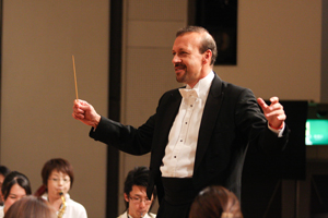 CCM Wind Orchestra music director and conductor Glenn D. Price.