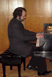 First year MM in Piano Performance student Kris Rucinski.