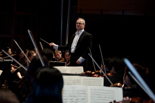 Mark Gibson and the CCM Philharmonia.