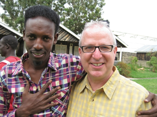 Drama professor Richard Hess (right) led a contingent of students to Kenya in 2011 where they met refugees such as Abdi Rashid, a writer (left), who translated Hess' words to Somali.