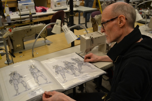 Professor and head of CCM's Costume Design and Technology Program Dean Mogle reviews costume renderings.