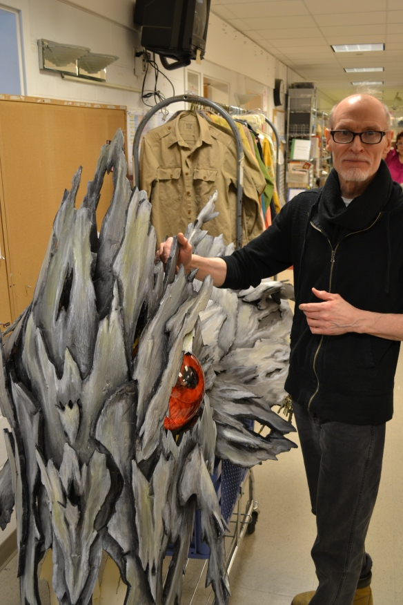 Professor and head of CCM's Costume Design and Technology Program Dean Mogle with the serpent head from the upcoming production of 'The Magic Flute.'