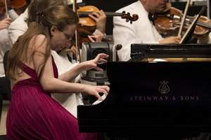 World Piano Competition : Gold winner Marianna Prjevalskaya of Spain performs during The World Piano Competition in the final round in the Corbett Auditorium Theater at the College Conservatory of Music on the University of Cincinnati campus. Courtesy of Enquirer Media.