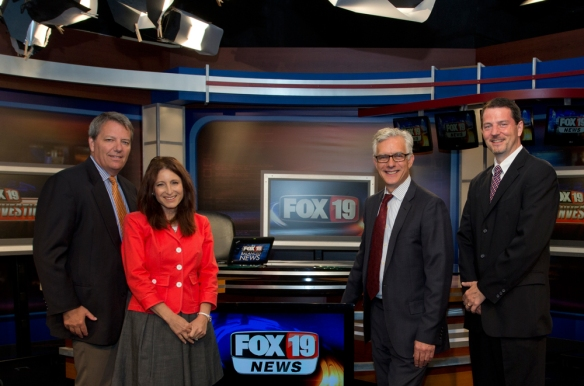 From left to right: Fox 19 General Manager Bill Lanesey and CCM Professor of Electronic Media Hagit Limor welcomed CCM Dean Peter Landgren and E-Media Division Head John Owens for a tour of the WXIX-TV news studio earlier this month. Professor Limor joins Fox 19′s newly expanded investigative team this fall. Photography by Dottie Stover.