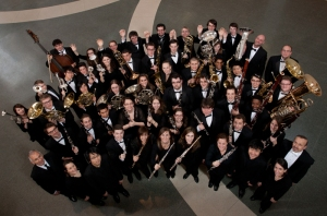 The CCM Wind Orchestra, with faculty members Terence Milligan (far left) and Glenn D. Price (far right). Photography by Dottie Stover.