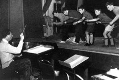 Britten rehearsing 'A Midsummer Night's Dream,' Op. 64, in Jubilee Hall in 1960. Image courtesy of www.britten100.org