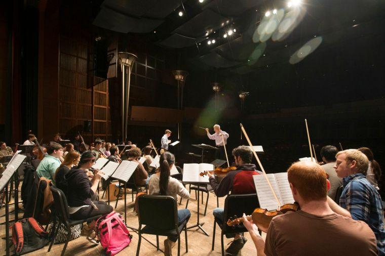 Earl Rivers leads the CCM Philharmonia in a rehearsal for John Adams' EL NINO. Photography by Lisa Ventre/University of Cincinnati.