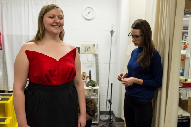 Maria Lenn built and draped this dashing red and black dress for Jessica Faselt (playing Hanna Glawari on Friday and Sunday) from Greta Stokes' designs. Lenn is fitting Faselt while Stokes and her assistant, Sarah Red Redden look on as Stokes' designs come to life. Photo by Steve Shin.