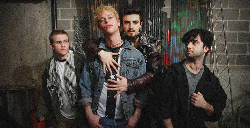 From left to right, Louis Griffin, Ben Biggers, John Battagliese and Chris Collins-Pisano in CCM's production of AMERICAN IDIOT. Photo by Mark Lyons.
