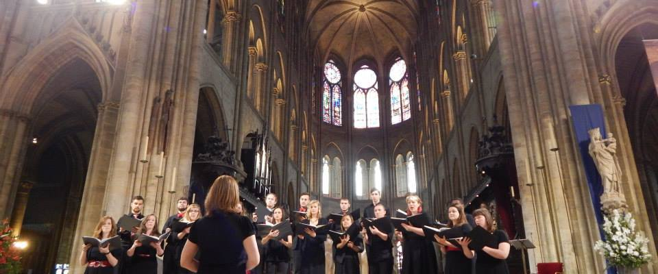 CCM Music Education students perform in the Notre Dame cathedral in Paris during a study abroad trip.