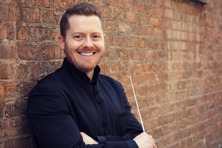 A portrait of conductor and educator Kevin Michael Holzman.