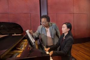 CCM Professor of Collaborative Piano Sandra Rivers coaches a student.