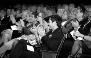 A black and white photo of an applauding crowd in CCM's Corbett Auditorium. Photo by Andrew Higley/UC Creative Services.