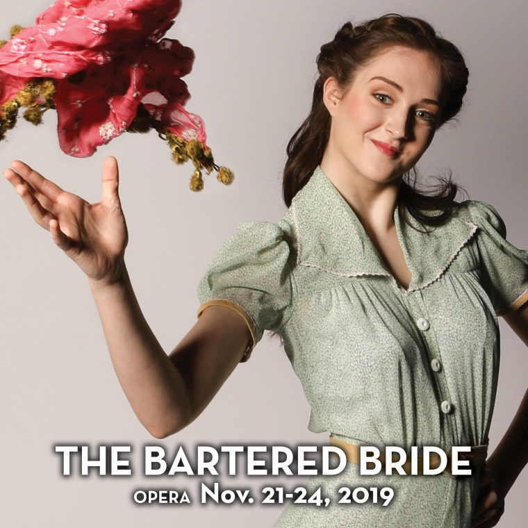 A woman throws a bouquet in a promotional image for the opera 'The Bartered Bride.' Photo by Mark Lyons.